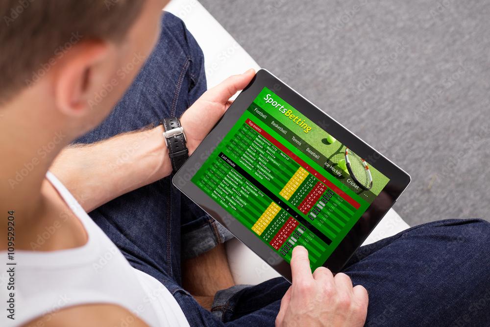 d98997e9c Fotografía Man using sports betting app on tablet | Europosters.es