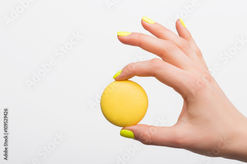 Poster Macarons Person holding yellow macaroon