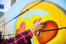 Graffiti Artist Spray Painting Wall, Venice Beach, California, USA