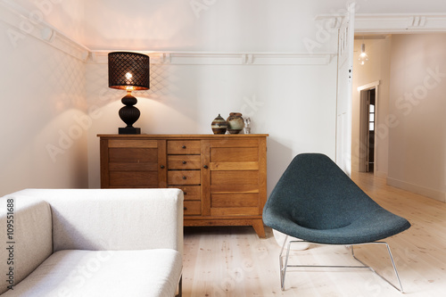 Fotografia, Obraz  Side board buffet chair and lamp in a luxury apartment renovatio