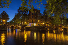 Canal Waterfront And Bridge At Night, Amsterdam, Netherlands