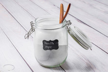 Glass Jar With Vanilla Sugar On A Wooden Table