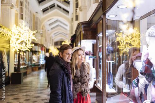 79ba8d93e Young couple window shopping in Burlington Arcade at xmas