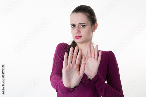 Fotografie, Obraz  Young woman shows palm of the hand meaning : stop