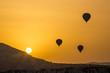 Balloons fly against the sun during sunrise, Cappadocia