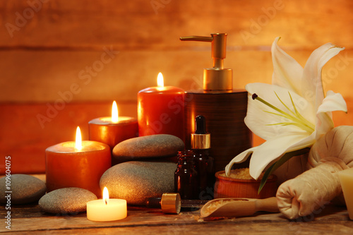 Fototapety, obrazy: Spa set with lighted candles on wooden background