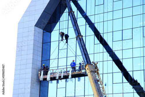 Fotografie, Obraz  Workers wash the modern office building