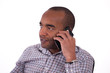 view young attractive black man work in a compagnie on the white background. he is phoning.