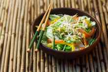 Thai Salad With Greens, Vegetables And Sprouts On A Bamboo Table