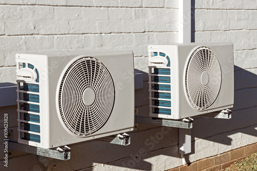 Photo Two Newly Installed Airconditioning Units Mounted on Walll