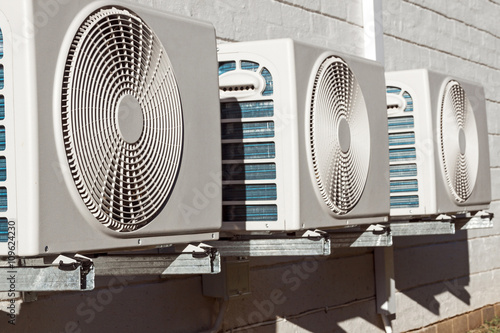 Photo Newly Installed Airconditioning Units Mounted on Brick Wall