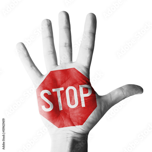 Hand raised gesture with stop sign painted, concept - isolated on white background
