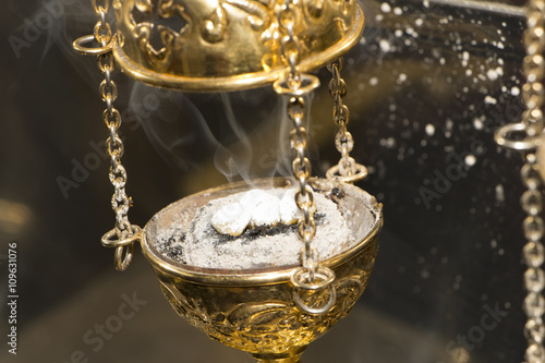 Valokuva  Brass thurible liturgy censer with burning incense in it