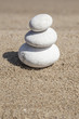 stack of pebble stones on balance on sand