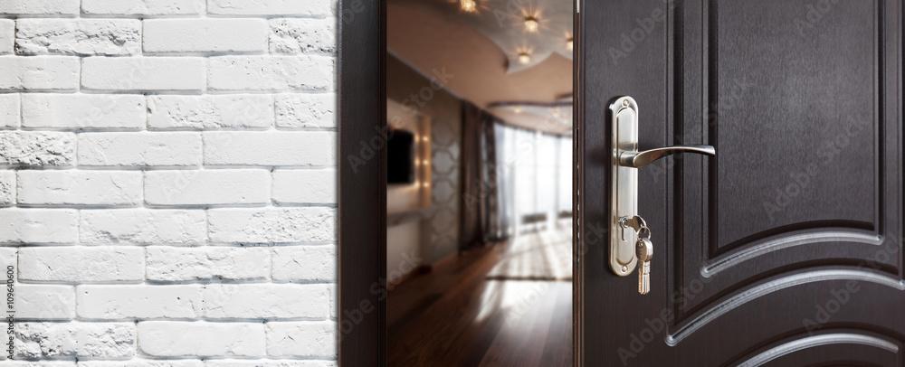 Fototapeta Half open door of a modern living room closeup.
