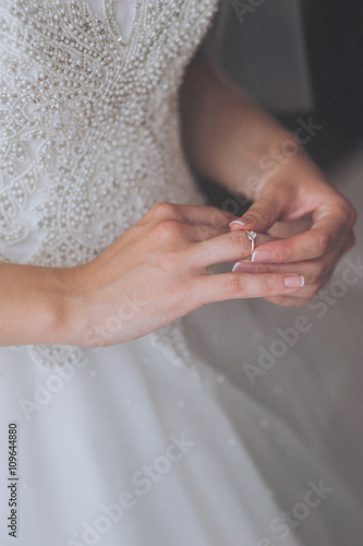 Foto op Canvas Pedicure jeweler bracelet on the bride's hand