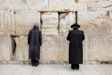 JERUSALEM, ISRAEL - MARCH 15, 2016: Two Men Praying At The Men's Section Of The Wailing (Western) Wall In The Old Town Jerusalem (Israel)