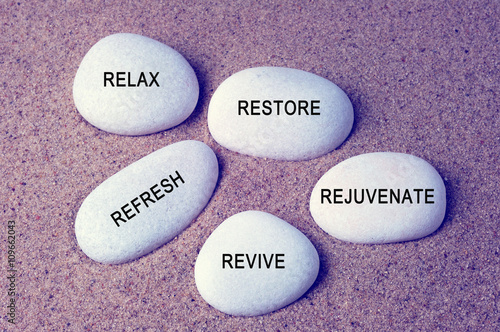 Foto op Plexiglas Stenen in het Zand Wellness, spa and beauty concept - Relax, restore, refresh, rejuvenate and revive text on zen stones retro style background