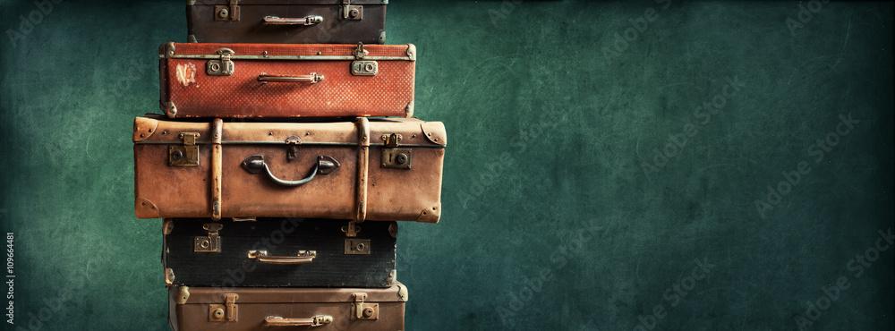 Fototapeta Vintage Pile Ancient Suitcases Design Long Format