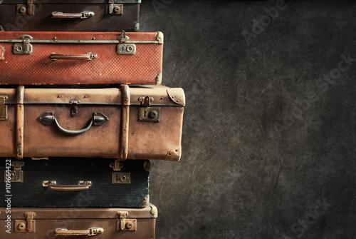Foto op Plexiglas Retro Vintage Ancient Suitcases Tower Concept Travel