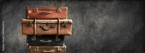 Foto op Plexiglas Retro Vintage Pile Ancient Suitcases Design Concept Travel