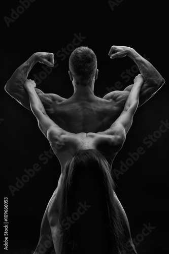 Nude sexy couple. Art photo of young adult man and woman. High contrast black and white muscular naked body - 109666053