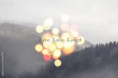 Photo  Live laugh love- inspirational message on mountain landscape