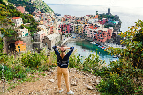 Poster Ligurie Young girl enjoying the view of Vernazza in Cinque terre, Liguria, Italy.
