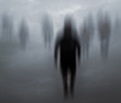 Leinwandbild Motiv Blurred mysterious people walking