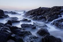 Rocky Sea Beach At Dusk