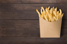 French Fries On Wooden Background. Top View