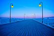 Beautiful wooden pier at sunset