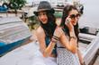 Two beautiful young women making selfie