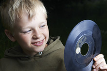 Young Boy Playing With The Vinyl Record
