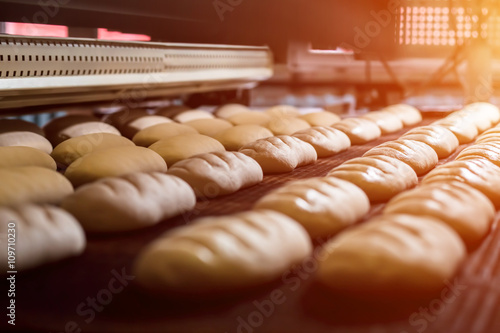 Canvas Prints Bread Dessert bread baking in oven. Production oven at the bakery. Baking bread. Manufacture of bread.