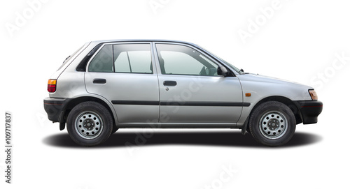 Small city car side view isolated on white © Konstantinos Moraiti