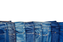 Row Of Fashion Different Jeans Isolated On White Background.