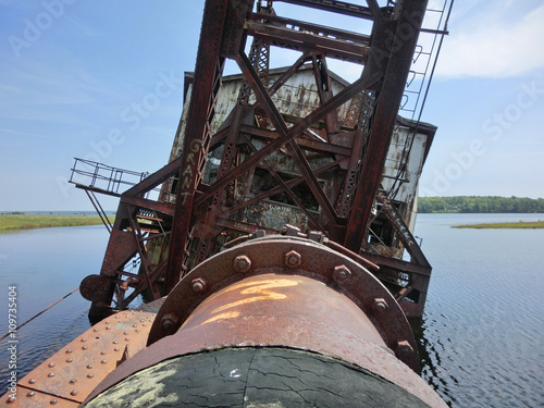Fotografia, Obraz  On the bridge of a vintage old industrial dredging ship, wrecked on shore