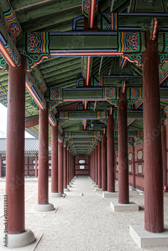 The porch between the pillars at Gyeonbokgung Palace, Seoul, South Korea Poster