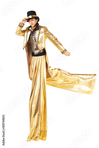 Boy in gold running on stilts Fototapet