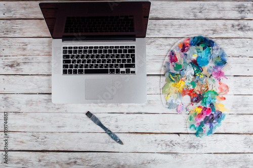laptop with used in a bright palette of colorful paint with brus Tablou Canvas