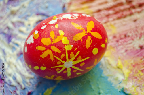 Single Easter Egg With Beautiful Color Abstract Pattern Isolated On Colored Textured Background