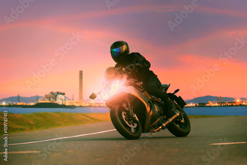 young man riding sport touring motorcycle on asphalt highways ag Poster