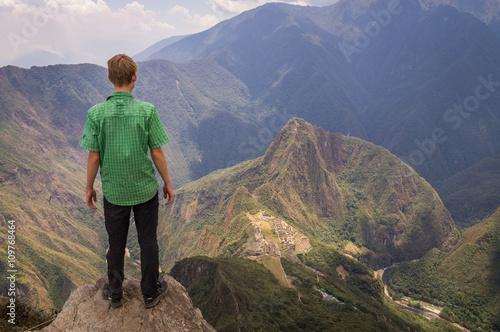 Spoed Foto op Canvas Zuid-Amerika land Tourist looking down on Inca city in Machu Picchu, Peru