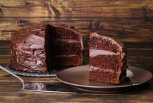 Chocolate Cake On Dark Wooden Bckground