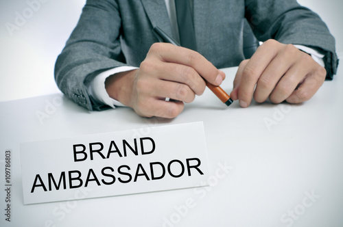 man and name plate with the text brand ambassador Canvas Print