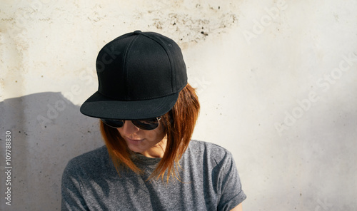 Fotografia  Portrait of a young attractive girl with cap