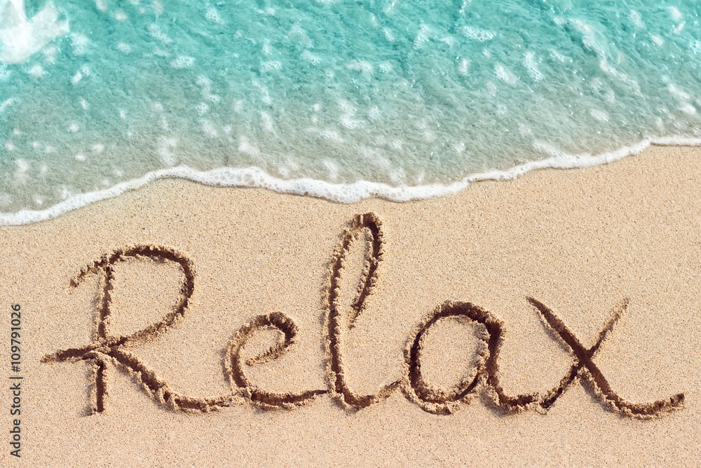 Fototapeta Word Relax is hand written on sand