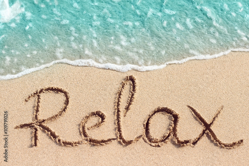 Obraz Word Relax is hand written on sand - fototapety do salonu