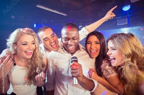 Fotografie, Obraz Happy friends singing at the karaoke